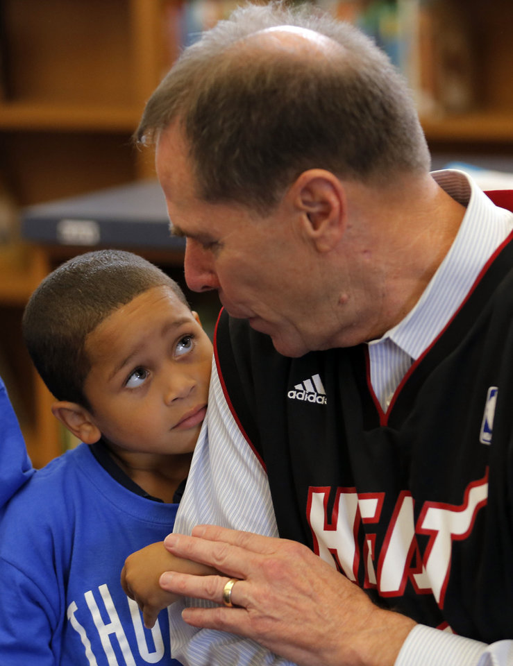 Photo - Superintendent Karl Springer talks with Nathaniel Hamilton at North Highland Elementary School last fall. Springer was making good on a bet with the Miami superintendent about which town's team would win the NBA Finals. Springer has been superintendent of the school district since 2008.  SARAH PHIPPS - THE OKLAHOMAN