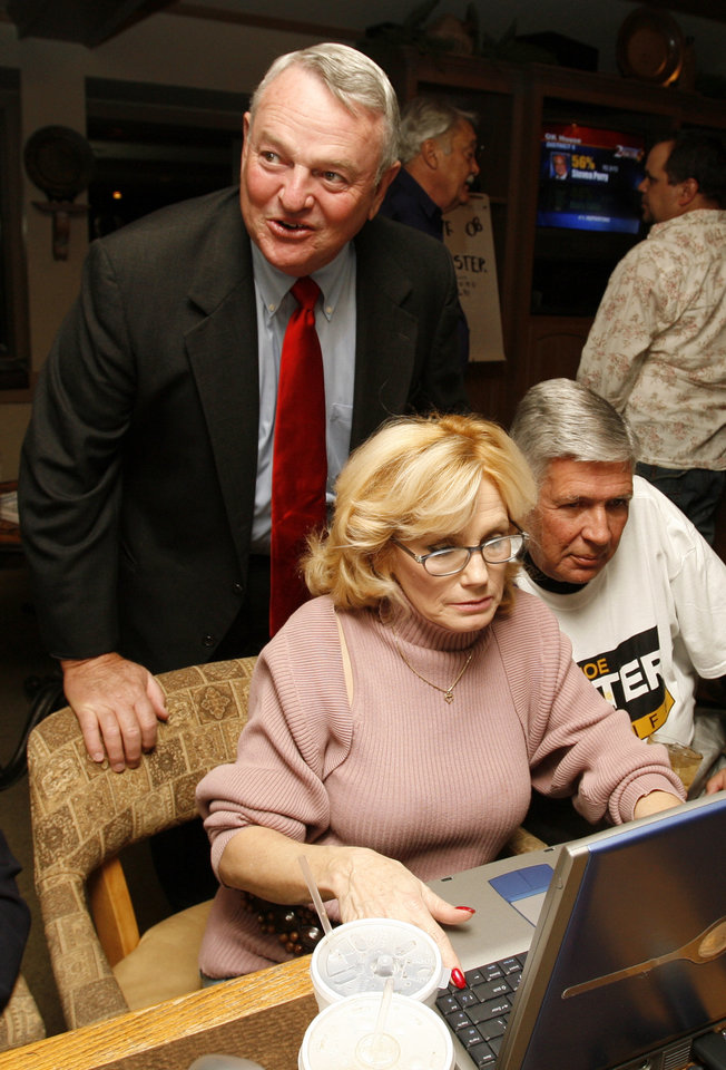 Photo - Joe Lester, candidate for Cleveland County Sheriff, looks at returns over the shoulder of Vickie Adams and Bob Williams on Tuesday, Nov. 4, 2008, in Norman, Okla.    Steve Sisney, The Oklahoman