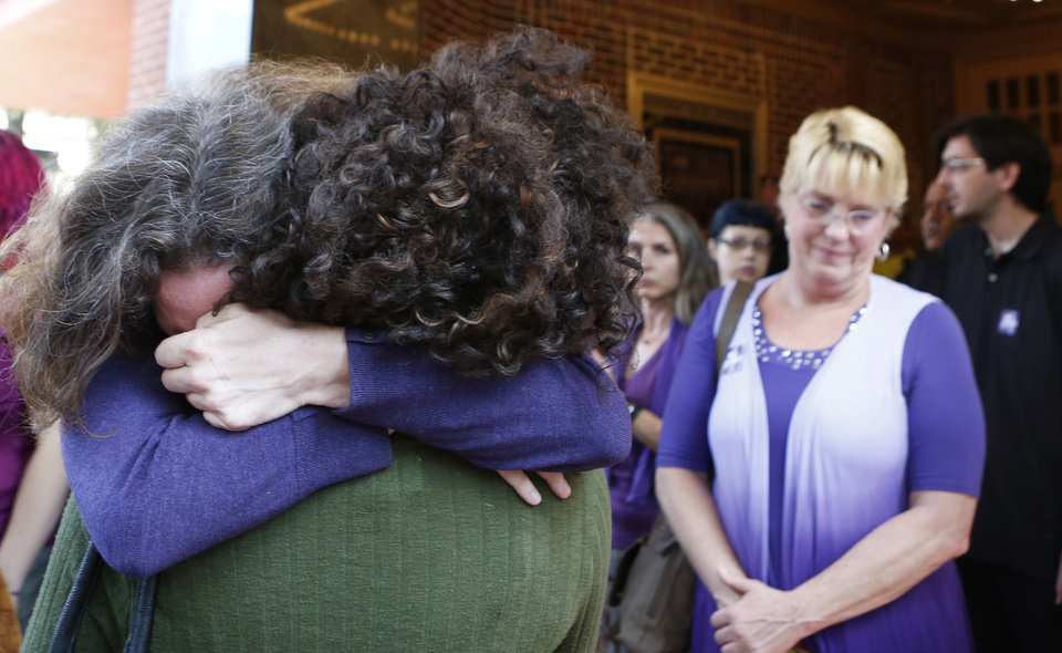 Photo - Women embrace outside the Paramount Theater after a memorial service for Heather Heyer on Wednesday, Aug. 16, 2017, in Charlottesville, Va. Heyer was killed Saturday, when a car rammed into a crowd of people protesting a white nationalist rally. (AP Photo/Julia Rendleman)