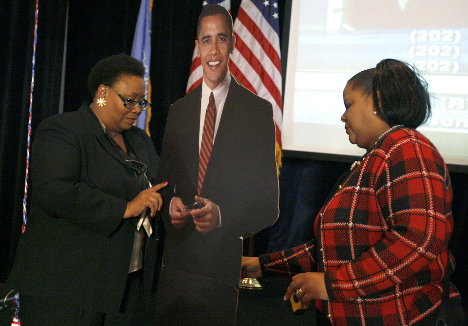 Photo - Diane Wood of Oklahoma City, left, and Jackie Gates of Midwest City look at a cut out of Barack Obama during the Democratic watch party for the presidential election in Oklahoma City, Tuesday, November 4, 2008. BY BRYAN TERRY, THE OKLAHOMAN