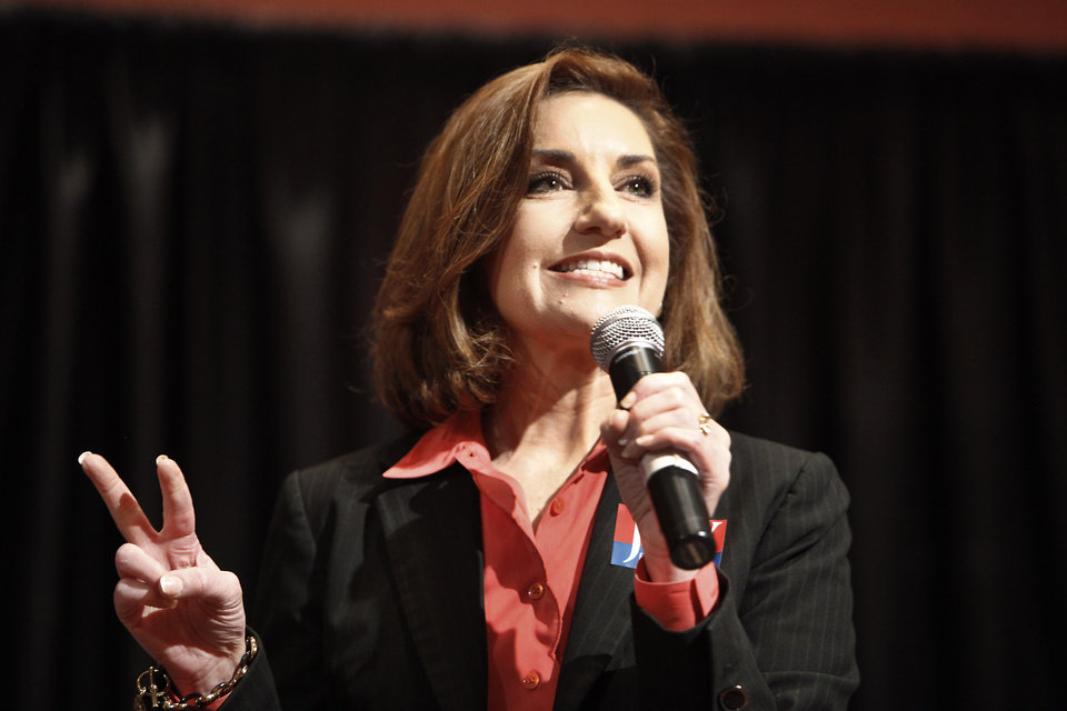 Photo - Joy Hofmeister  candidate for state school superintendent participating in a debate during summer conference for Cooperative Council for Oklahoma School Administration (CCOSA) in Norman, Friday, June 6, 2014.   Photo by David McDaniel, The Oklahoman