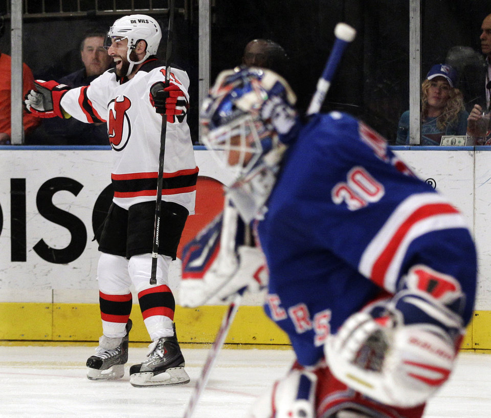 Photo -   New Jersey Devils' Stephen Gionta, left, celebrates after scoring a goal past New York Rangers goalie Henrik Lundqvist, of Sweden, right, during the first period of Game 5 of an NHL hockey Stanley Cup Eastern Conference final playoff series, Wednesday, May 23, 2012, in New York. (AP Photo/Frank Franklin II)