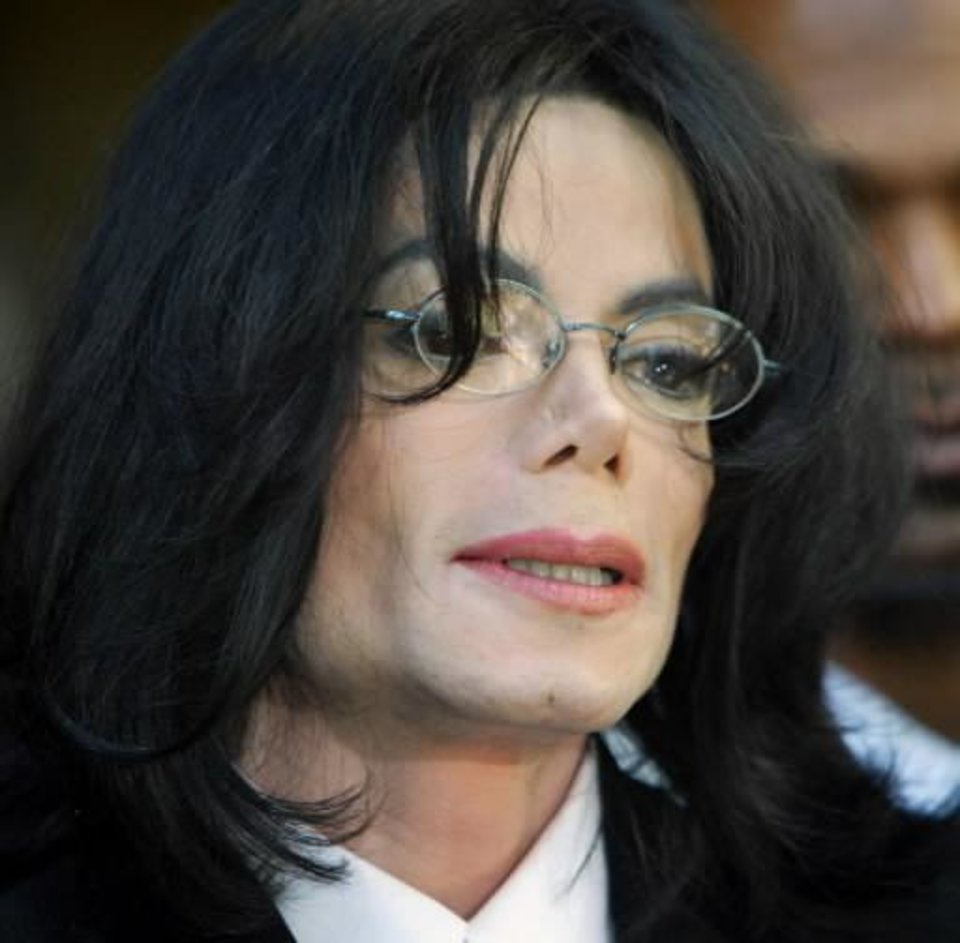 Photo - In this April 30, 2004  file picture,  Michael  Jackson speaks at a news conference after his arraignment at the Santa Maria, Calif. courthouse. (AP Photo/Pool, Stephen Osman)