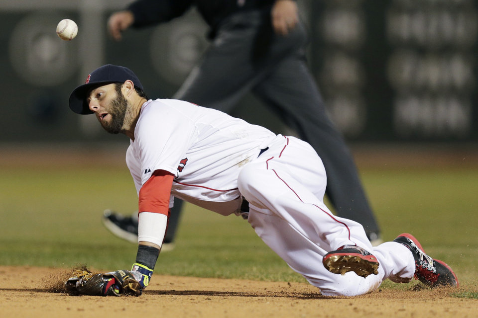 Photo - Boston Red Sox second baseman Dustin Pedroia knocks down the ball on a ground out by Texas Ranger J.P. Arencibia during the fifth inning of the MLB American League  baseball game at Fenway Park, Monday, April 7, 2014, in Boston.(AP Photo/Charles Krupa)
