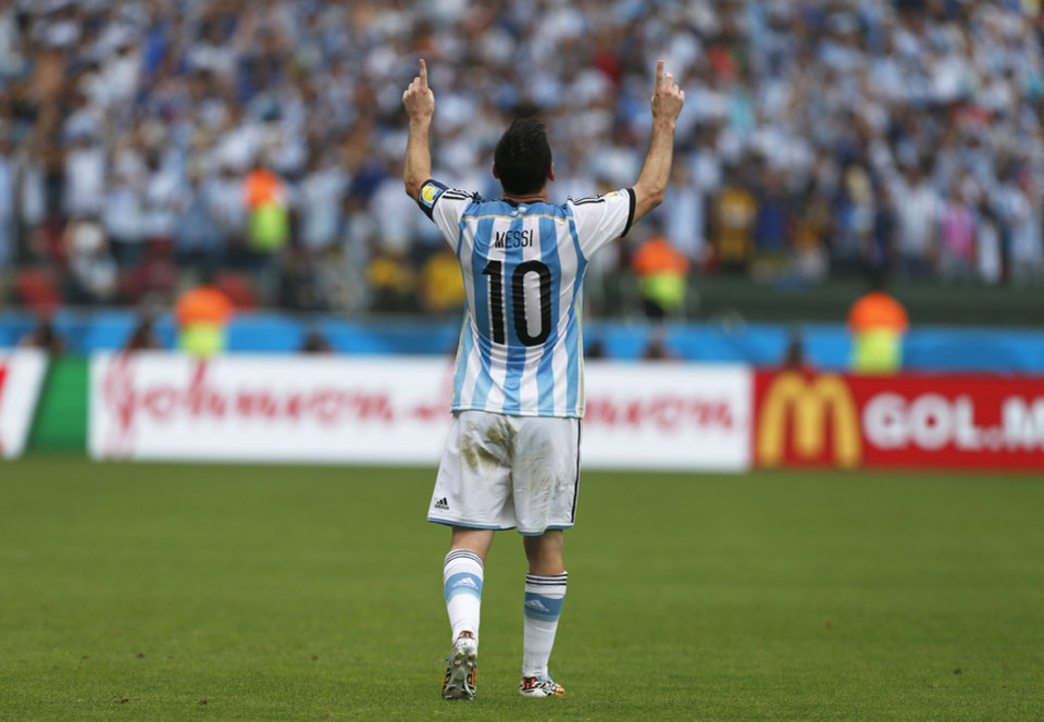 Photo - Argentina's Lionel Messi celebrates after scoring his side's second goal during the group F World Cup soccer match against Nigeria at the Estadio Beira-Rio in Porto Alegre, Brazil, Wednesday, June 25, 2014. (AP Photo/Jon Super)