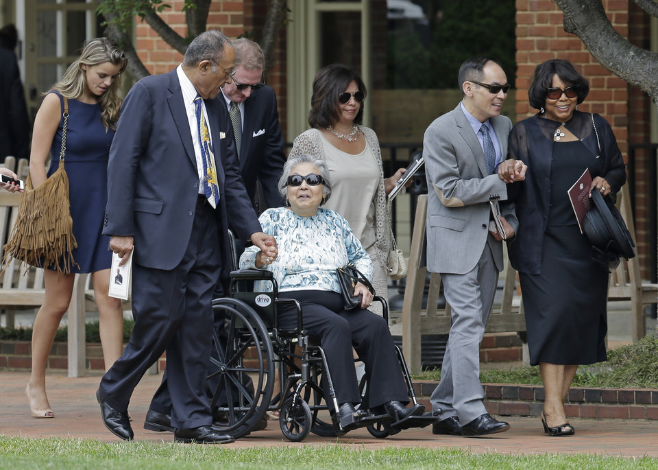 Photo - Mourners leave Wait Chapel after a memorial service for poet and author Maya Angelou at Wait Chapel. at Wake Forest University in Winston-Salem, N.C., Saturday, June 7, 2014. Former President Bill Clinton and Oprah Winfrey joined First Lady Michelle Obama at the service. (AP Photo/Chuck Burton)