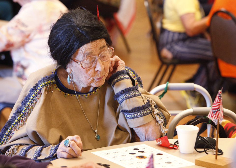 Mary Adams wears a Native American costume she made. She is playing trick-or-treat bingo at the Edmond Senior Center. PHOTO BY DAVID MCDANIEL, THE OKLAHOMAN. <strong>David McDaniel - The Oklahoman</strong>