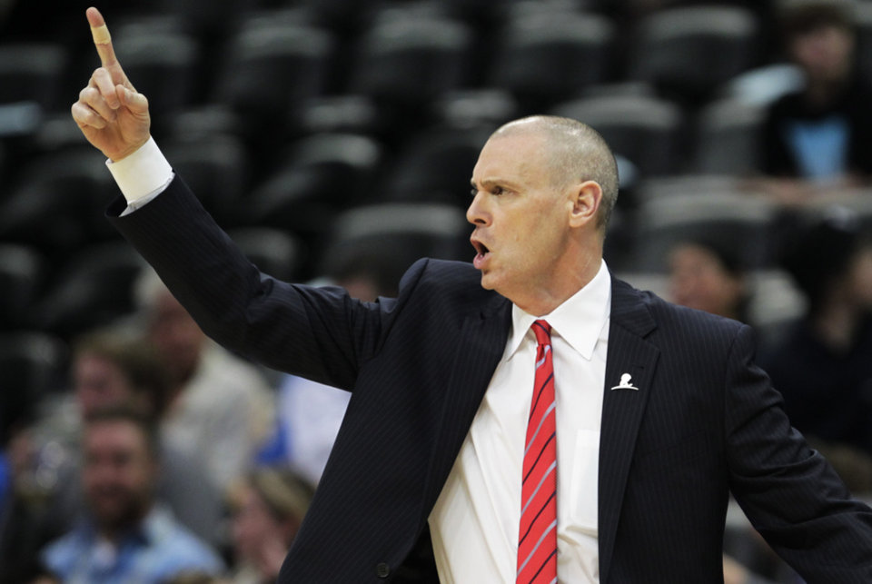 Photo - Dallas Mavericks coach Rick Carlisle directs his team in the first quarter of an NBA game in Denver on Wednesday, March 5, 2014.(AP Photo/Joe Mahoney)