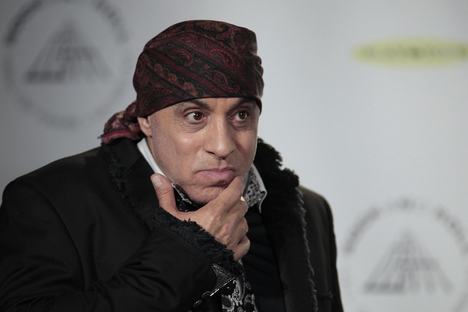 Photo - Hall of Fame inductee Steven Van Zandt appears in the press room at the 2014 Rock and Roll Hall of Fame Induction Ceremony on Thursday, April, 10, 2014 in New York. (Photo by Andy Kropa/Invision/AP)