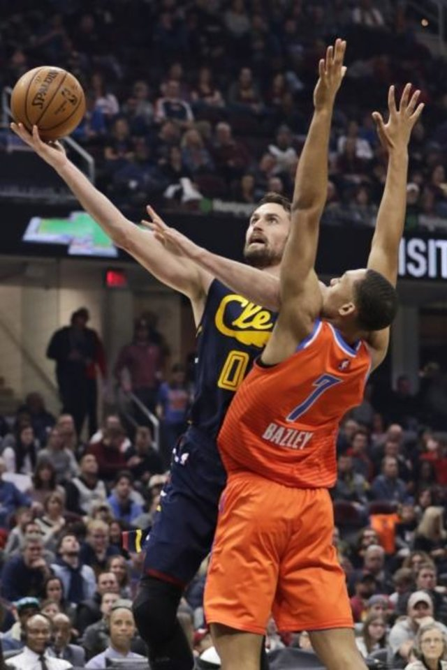Photo -  Cavaliers forward Kevin Love (0) shoots against Thunder rookie Darius Bazley (7) in the first half Saturday. [AP Photo/Tony Dejak]