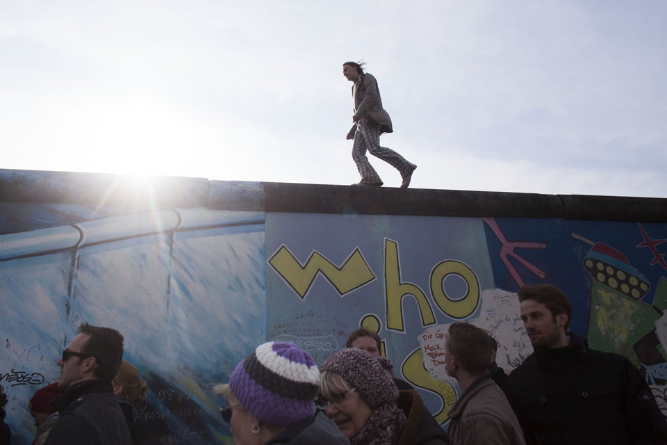 Photo - A man walks over the East Side Gallery named part of the former Berlin Wall during a protest against the removal of a section of the historic part of the former Wall, in Berlin, Sunday, March 17, 2013.  (AP Photo/Markus Schreiber)