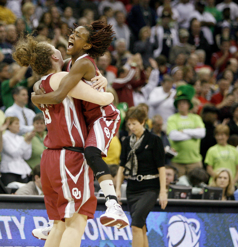 Photo - OU's Danielle Robinson and Joanna McFarland, left, celebrate as Notre Dame coach Muffet McGraw walks to half court after the Sweet 16 round of the NCAA women's  basketball tournament in Kansas City, Mo., on Sunday, March 28, 2010. 