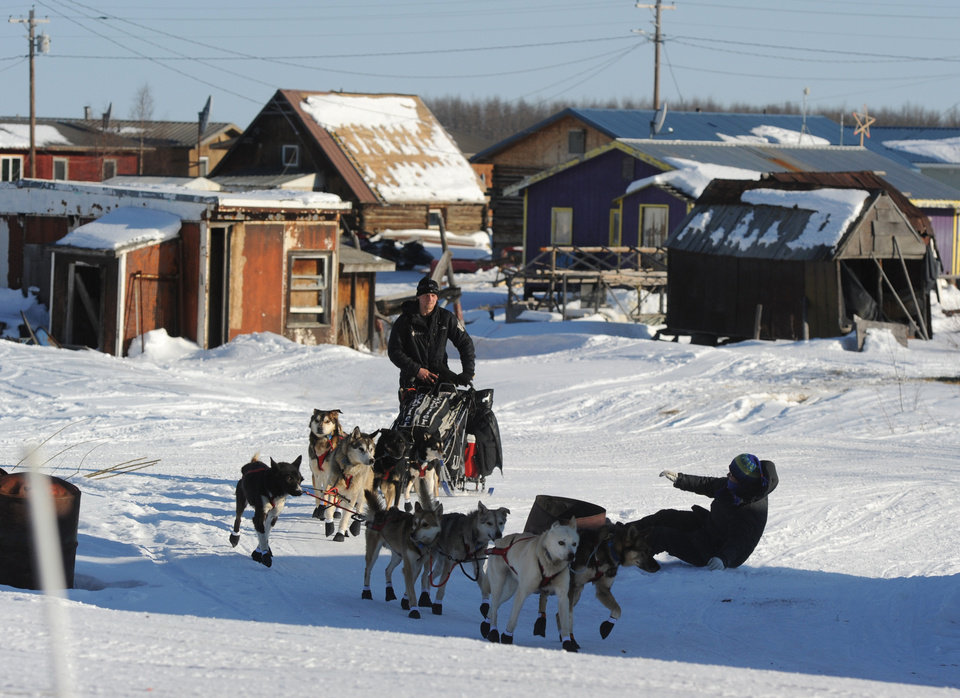 Photo - Dallas Seavey leaves the Yukon River village of Kaltag during the 2014 Iditarod Trail Sled Dog Race on Saturday, March 8, 2014. (AP Photo/The Anchorage Daily News, Bob Hallinen)