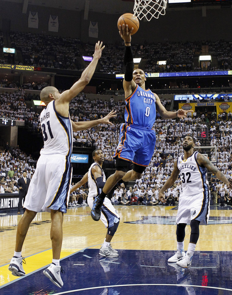 Photo - Oklahoma City Thunder guard Russell Westbrook (0) drives between Memphis Grizzlies forward Shane Battier (31) and O. J. Mayo (32) during the first half of Game 6 of a second-round NBA basketball playoff series on Friday, May 13, 2011, in Memphis, Tenn. (AP Photo/Lance Murphey)
