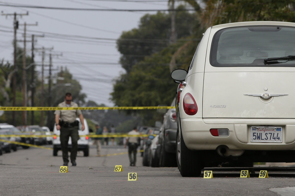 Photo - Markers are placed at the scene of a shooting on Saturday, May 24, 2014, in Isla Vista, Calif. A drive-by shooter went on a rampage near a Santa Barbara university campus that left seven people dead, including the attacker, and others wounded, authorities said Saturday. (AP Photo/Jae C. Hong)