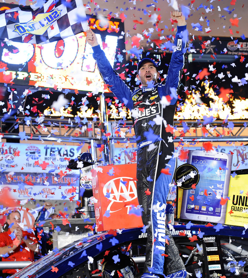 Photo - Jimmie Johnson (48) celebrates winning the NASCAR Sprint Cup series auto race at Texas Motor Speedway in Fort Worth, Texas, Sunday, Nov. 3, 2013. (AP Photo/Ralph Lauer)