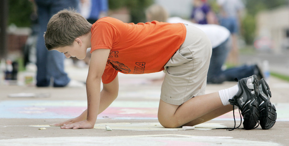 "John Robertson, 12, of Norman works on his dancing pear for his entry ""Dancing Fruit"" in the Cleveland county CROP walk to stop hunger Sidewalk Chalk Art contest for Kids and Families Saturday, Sept. 13, at the Santa Fe Depot in Norman, OK. BY JACONNA AGUIRRE, THE OKLAHOMAN"