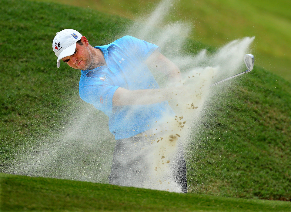 Photo - Corey Conners, of Canada, takes a shot on the 18th hole during the 2014 U.S. Amateur Championship at Atlanta Athletic Club on Sunday, Aug. 17, 2014, in Johns Creek, Ga. (AP Photo/Atlanta Journal-Constitution, Curtis Compton)  MARIETTA DAILY OUT; GWINNETT DAILY POST OUT; LOCAL TV OUT; WXIA-TV OUT; WGCL-TV OUT