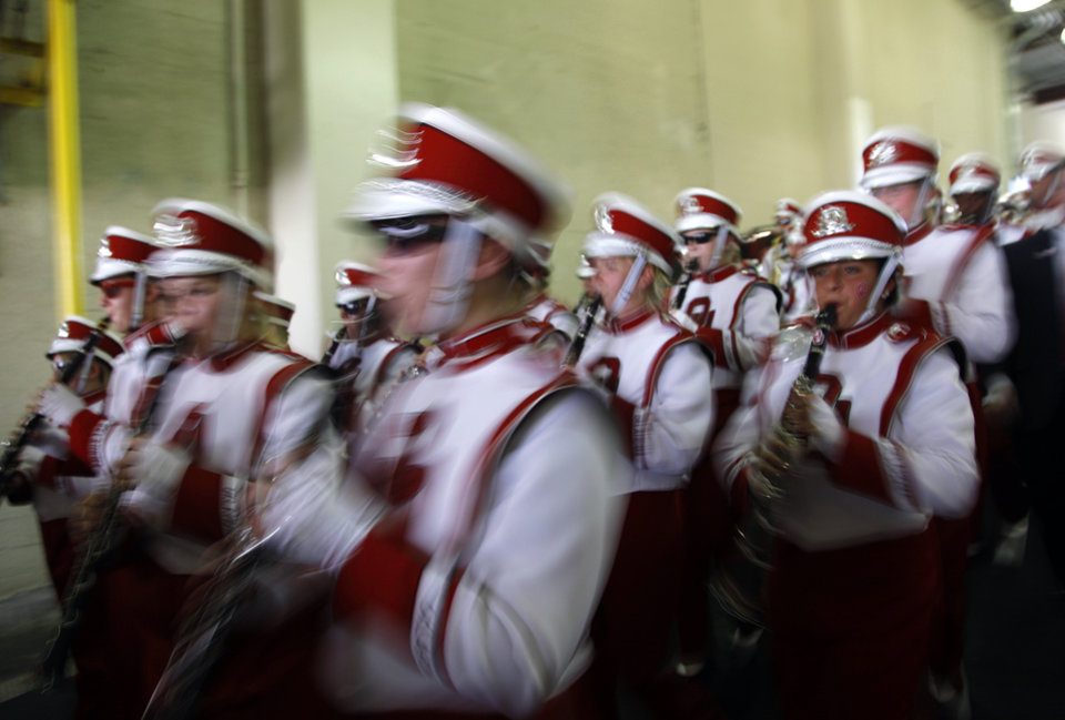 Photo - Members of the Pride of Oklahoma marching band make their way to the field before the start of the Red River Rivalry college football game between the University of Oklahoma Sooners (OU) and the University of Texas Longhorns (UT) at the Cotton Bowl on Saturday, Oct. 2, 2010, in Dallas, Texas.   Photo by Chris Landsberger, The Oklahoman