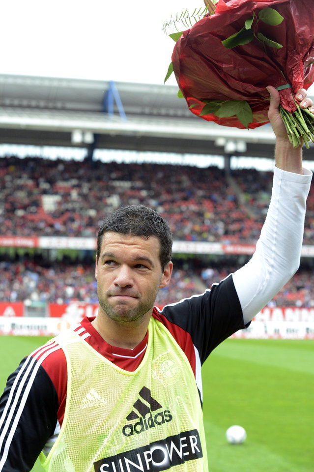 Photo -   FILE - In this May 5, 2012 file photo Leverkusen's Michael Ballack waves with a bunch of flowers prior to the German first division soccer match between 1. FC Nuremberg and Bayer 04 Leverkusen, in Nuremberg, Germany. It is Ballack's last match with his team. 36 year-old former captain of the German national soccer team Ballack announced on Tuesday, Oct. 2, 2012 that he will end his active career. (AP Photo/dapd, Tim Schamberger)