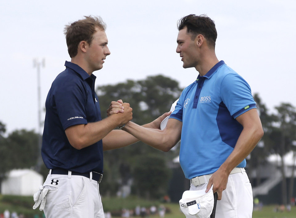 Photo - Jordan Spieth, left, and Martin Kaymer of Germany, shake hands at the end of the third round of The Players championship golf tournament at TPC Sawgrass, Saturday, May 10, 2014 in Ponte Vedra Beach, Fla. (AP Photo/Lynne Sladky)
