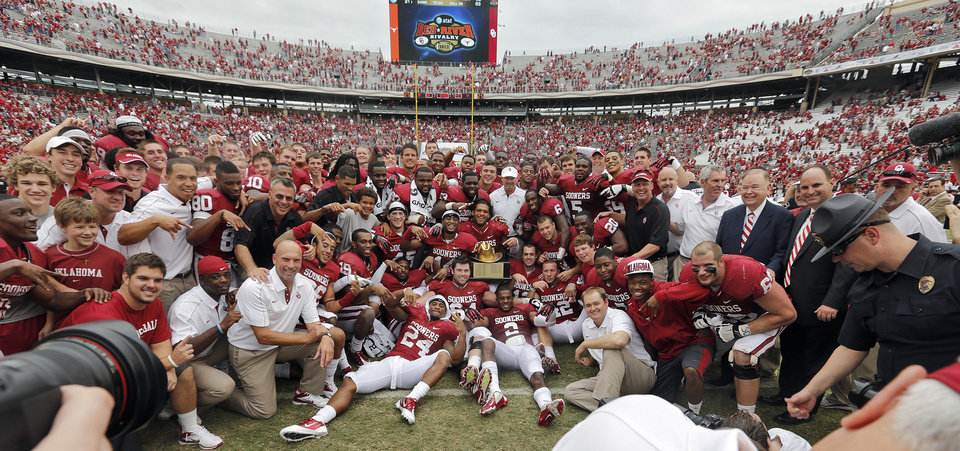 Photo - The Sooners pose for the team photo after the 63-21 win over Texas during the Red River Rivalry college football game between the University of Oklahoma (OU) and the University of Texas (UT) at the Cotton Bowl in Dallas, Saturday, Oct. 13, 2012. Photo by Chris Landsberger, The Oklahoman