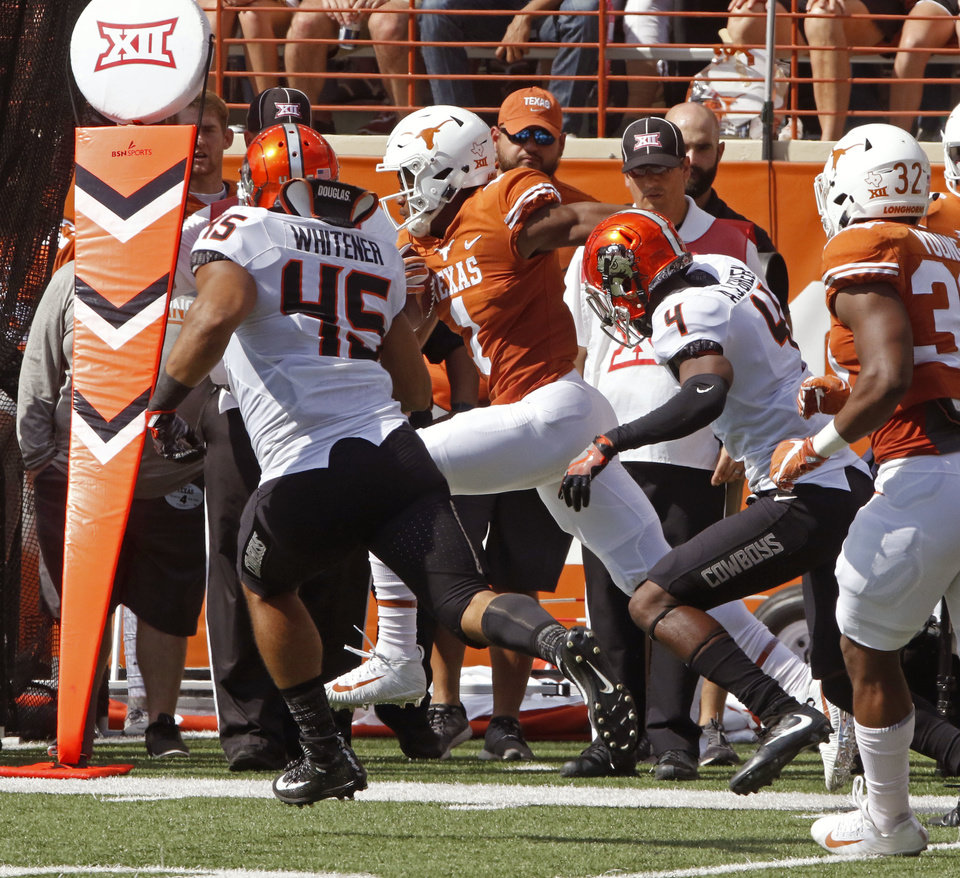 Photo - Texas receiver John Burt (1) runs for a 90-yard touchdown against Oklahoma State linebacker Chad Whitener (45) and defensive back A.J. Green (4) during the first half of an NCAA college football game, Saturday, Oct. 21, 2017, in Austin, Texas. (AP Photo/Michael Thomas)