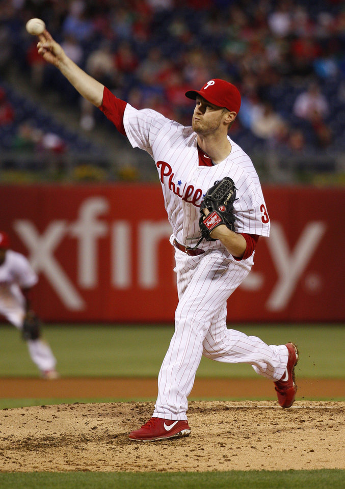 Photo - Philadelphia Phillies' starting pitcher Kyle Kendrick pitches during the fourth inning of a baseball game against the Cincinnati Reds, Friday, May 16, 2014, in Philadelphia. (AP Photo/Chris Szagola)