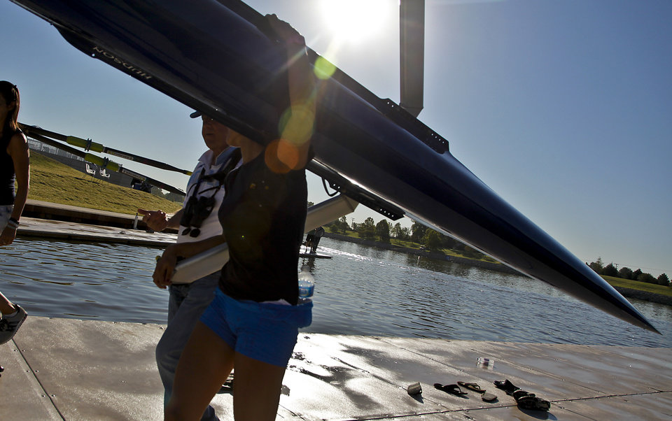 A rowing competitor carries a shell to the Devon Boathouse during the Oklahoma Regatta Festival at the Oklahoma River on Saturday, Oct. 1, 2011, in Oklahoma City, Okla. Photo by Chris Landsberger, The Oklahoman