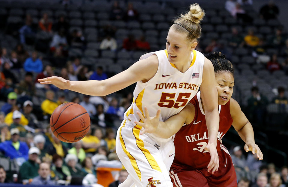 Photo - Oklahoma's Portia Durrett (31) tries to get the ball frm Iowa State's Anna Prins (55) during the Big 12 tournament women's college basketball game between the University of Oklahoma and Iowa State University at American Airlines Arena in Dallas, Sunday, March 10, 2012.  Oklahoma lost 79-60. Photo by Bryan Terry, The Oklahoman