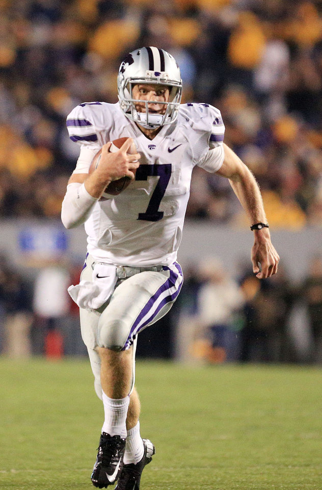 Photo -   Kansas State quarterback Collin Klein runs with the ball during an NCAA college football game against West Virginia in Morgantown, W.Va., Saturday, Oct. 20, 2012. Kansas State won 55-14. (AP Photo/Christopher Jackson)