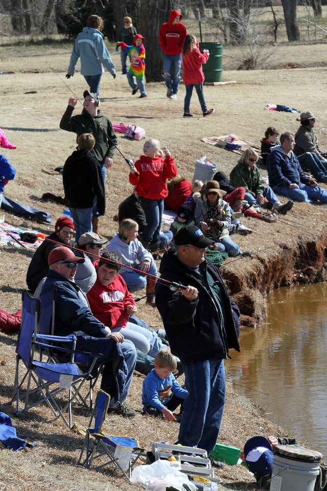 It was fun for all ages during the Trout Fish Out Saturday, March 2, 2013, morning at the Dale Robertson Activity Center pond in Yukon. PHOTO BY HUGH SCOTT FOR THE OKLAHOMAN