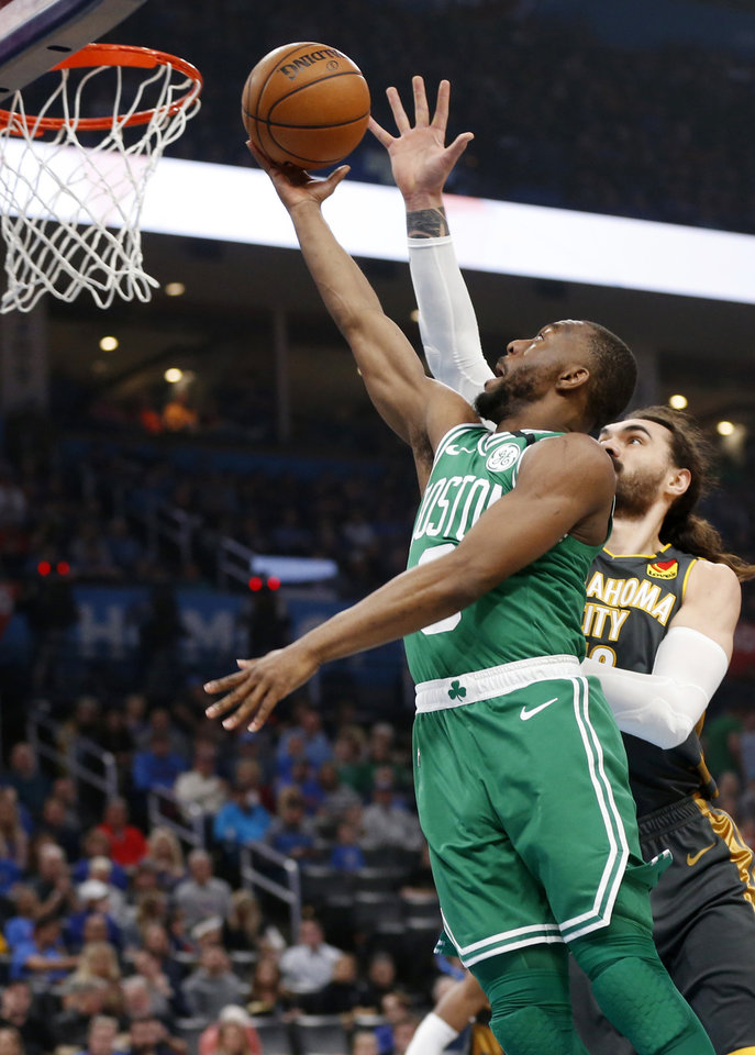 Photo - Boston's Kemba Walker (8) takes the ball to the basket past Oklahoma City's Steven Adams (12) in the first quarter during an NBA basketball game between the Oklahoma City Thunder and the Boston Celtics at Chesapeake Energy Arena in Oklahoma City, Sunday, Feb. 9, 2020. [Nate Billings/The Oklahoman]