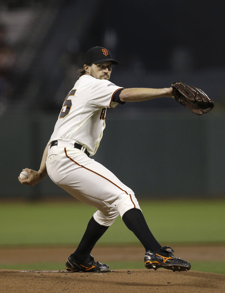 Photo - San Francisco Giants pitcher Barry Zito throws to a Los Angeles Dodgers batter during the first inning of a baseball game in San Francisco, Wednesday, Sept. 25, 2013. (AP Photo/Jeff Chiu)