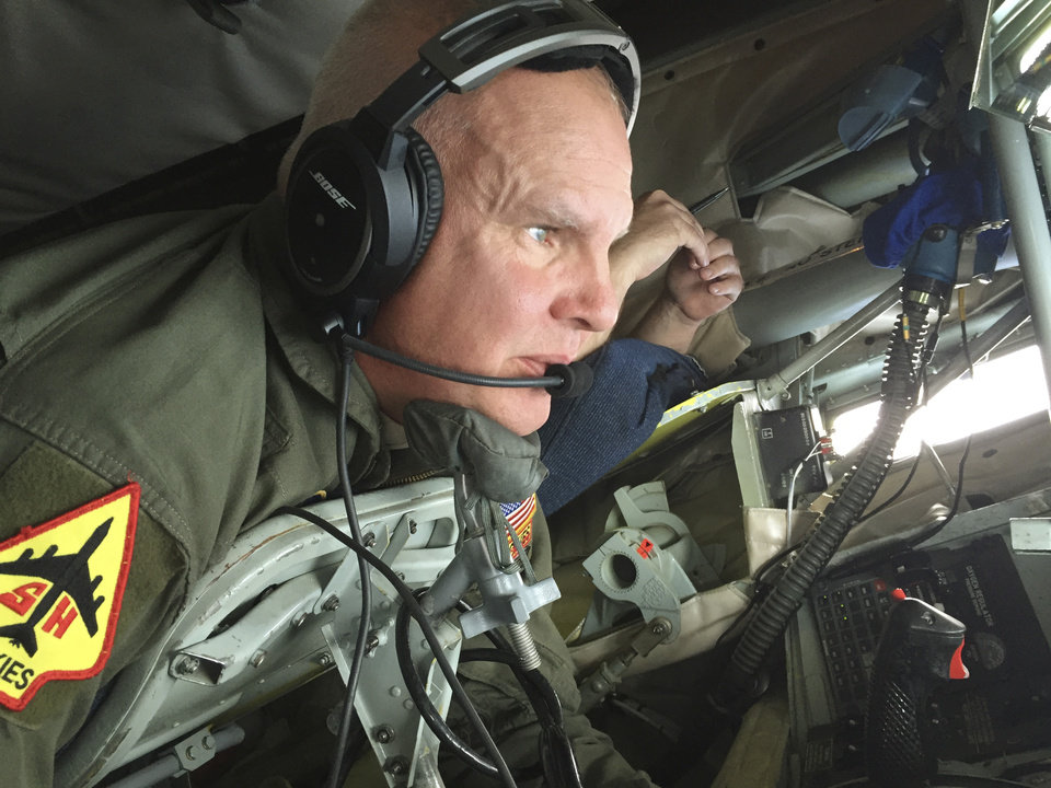 Photo -  Master Sgt. Steven Stanton, with the 507th Air Refueling Wing, lies in the pod of a KC-135 tanker and operates the controls of a refueling boom as a B-52 bomber maneuvers into position during a practice flight.