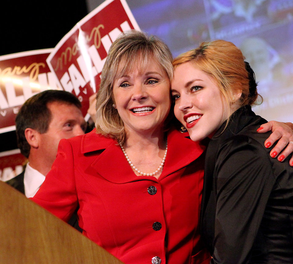 Photo - Mary Fallin hugs her daughter Christina Fallin as she speaks to supporters at the Will Rogers Theater in Oklahoma City, Oklahoma on Tuesday, July 27, 2010.  Photo by John Clanton, The Oklahoman