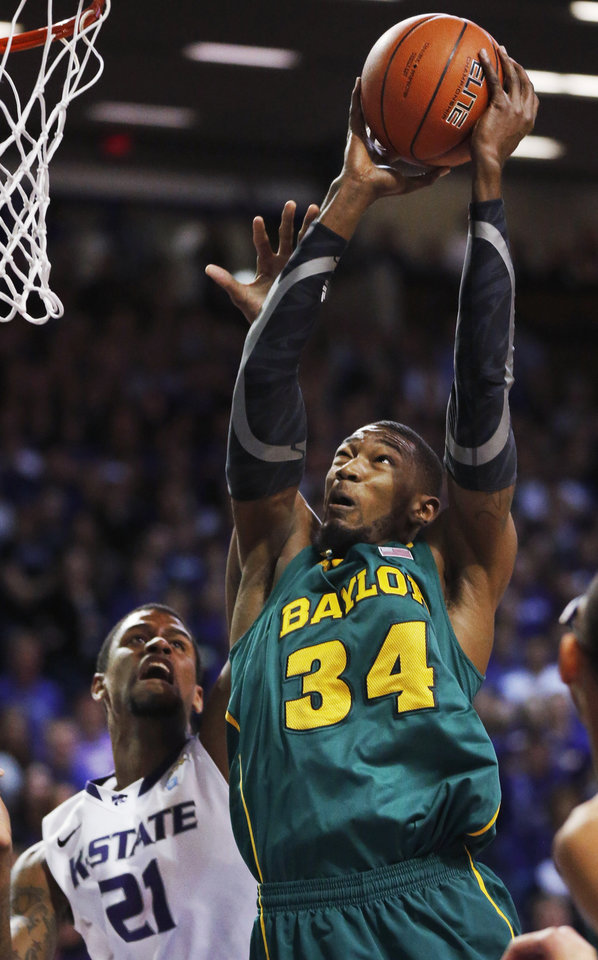 Baylor forward Cory Jefferson (34) is fouled by Kansas State forward Jordan Henriquez (21) during the first half of an NCAA college basketball game in Manhattan, Kan., Saturday, Feb. 16, 2013. (AP Photo/Orlin Wagner)