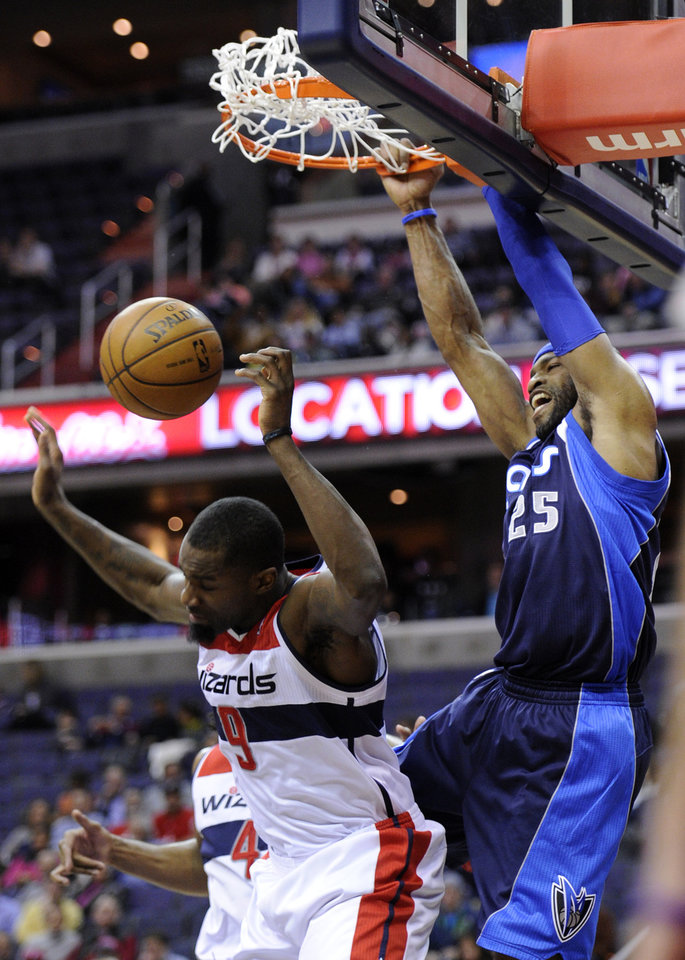 Dallas Mavericks guard Vince Carter (25) dunks over Washington Wizards forward Martell Webster (9) during the first half of an NBA basketball game, Tuesday, Jan. 1, 2013, in Washington. (AP Photo/Nick Wass)