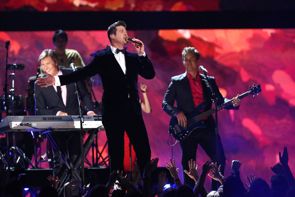 Photo - Robin Thicke, center, performs on stage with Peter Cetera, left, and Robert Lamm, right, of Chicago at the 56th annual GRAMMY Awards at Staples Center on Sunday, Jan. 26, 2014, in Los Angeles. (Photo by Matt Sayles/Invision/AP)
