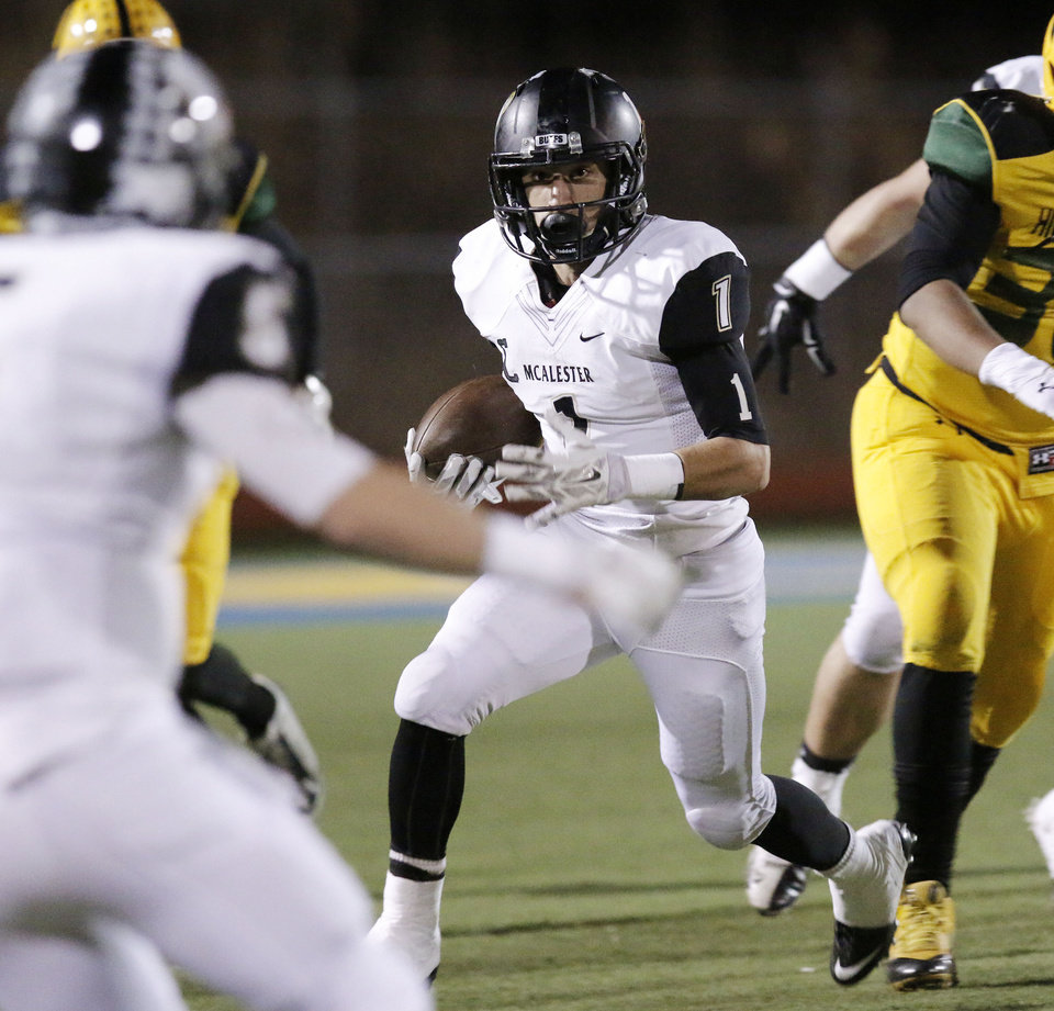 Photo - MHS #1 Cameron Hunter makes his way upfield during the high school football playoff between McAlester and Lawton MacArthur at Choctaw stadium, November 28, 2014. Photo by Doug Hoke, The Oklahoman