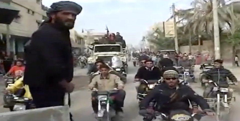 Photo -   This citizen journalist image made from video provided by Shaam News Network which has been authenticated based on its contents and other AP reporting, shows Syrian rebels celebrating the takeover of Mayadeen military base near Deir el-Zour, Thursday, Nov. 22, 2012. Syrian rebels strengthened their hold in an oil-rich strategic province bordering Iraq, capturing a key military base that was considered the last bastion for regime forces in the area. (AP Photo/Shaam News Network via AP video)