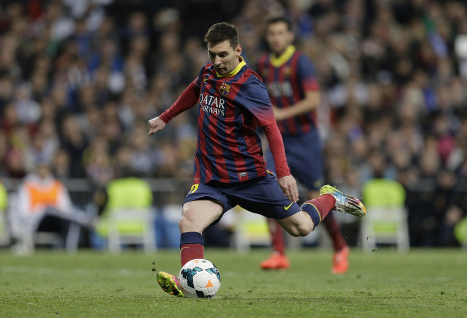 Photo - FC Barcelona's Lionel Messi from Argentina scores a penalty  during a Spanish La Liga soccer match against Real Madrid,  at the Santiago Bernabeu stadium in Madrid, Sunday March 23, 2014. (AP Photo/Paul White)