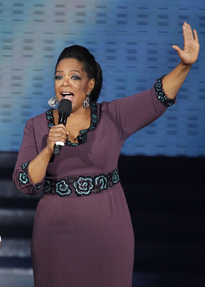 "FILE - In this May 17, 2011 file photo, Oprah Winfrey acknowledges fans during a star-studded double-taping of ""Surprise Oprah! A Farewell Spectacular, in Chicago. ""The Oprah Winfrey Show"" is ending its run May 25, after 25 years. (AP Photo/Charles Rex Arbogast, file)"