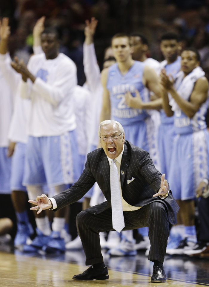 Photo - North Carolina head coach Roy Williams emotes on the sideline against Iowa State during the second half of a third-round game in the NCAA college basketball tournament Sunday, March 23, 2014, in San Antonio. (AP Photo/David J. Phillip)