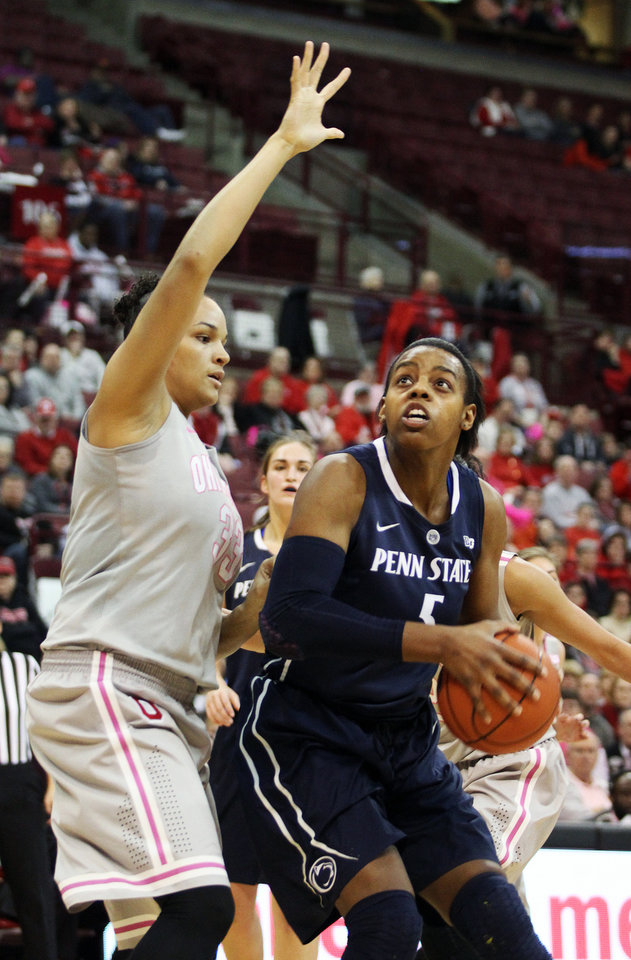 Photo - Penn State's Talia East, right, looks to shoot under pressure by Ohio State's Ashley Adams during the second half of an NCAA women's college basketball game, Sunday, Feb. 9, 2014, in Columbus, Ohio. Penn State won 74-54. (AP Photo/Mike Munden)
