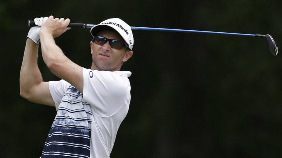 Photo - Tim Wilkinson watches his tee shot on the 12th hole during the first round of the PGA Colonial golf tournament in Fort Worth, Texas. Thursday, May 22, 2014. (AP Photo/LM Otero)