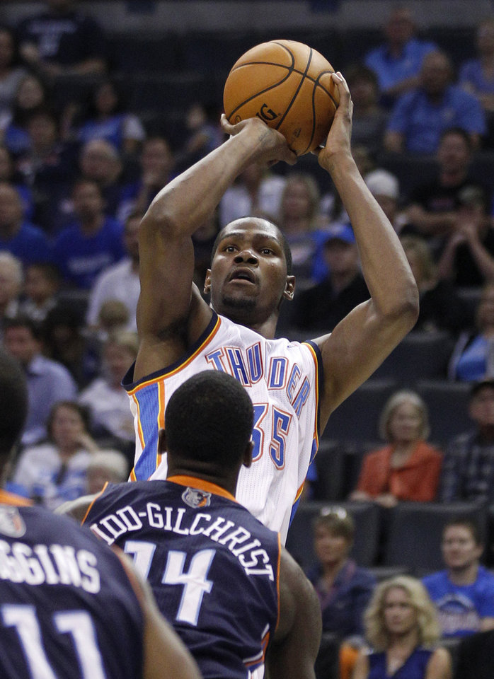 Photo -   Oklahoma City Thunder forward Kevin Durant (35) shoots over Charlotte Bobcats forward Michael Kidd-Gilchrist (14) during the second quarter of a preseason NBA basketball game in Oklahoma City, Tuesday, Oct. 16, 2012. (AP Photo/Sue Ogrocki)