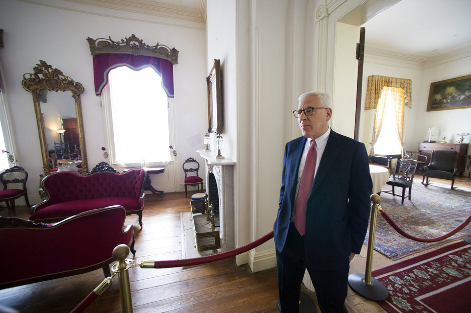 Photo - Philanthropist David Rubenstein walks through the historic Arlington House at Arlington National Cemetery in Arlington, Va., Thursday, July 17, 2014. The historic house and plantation originally built as a monument to George Washington overlooking the nation's capital that later was home to Confederate Gen. Robert E. Lee and 63 slaves will be restored to its historical appearance after a $12.3 million gift from Philanthropist David Rubenstein. (AP Photo/Cliff Owen)