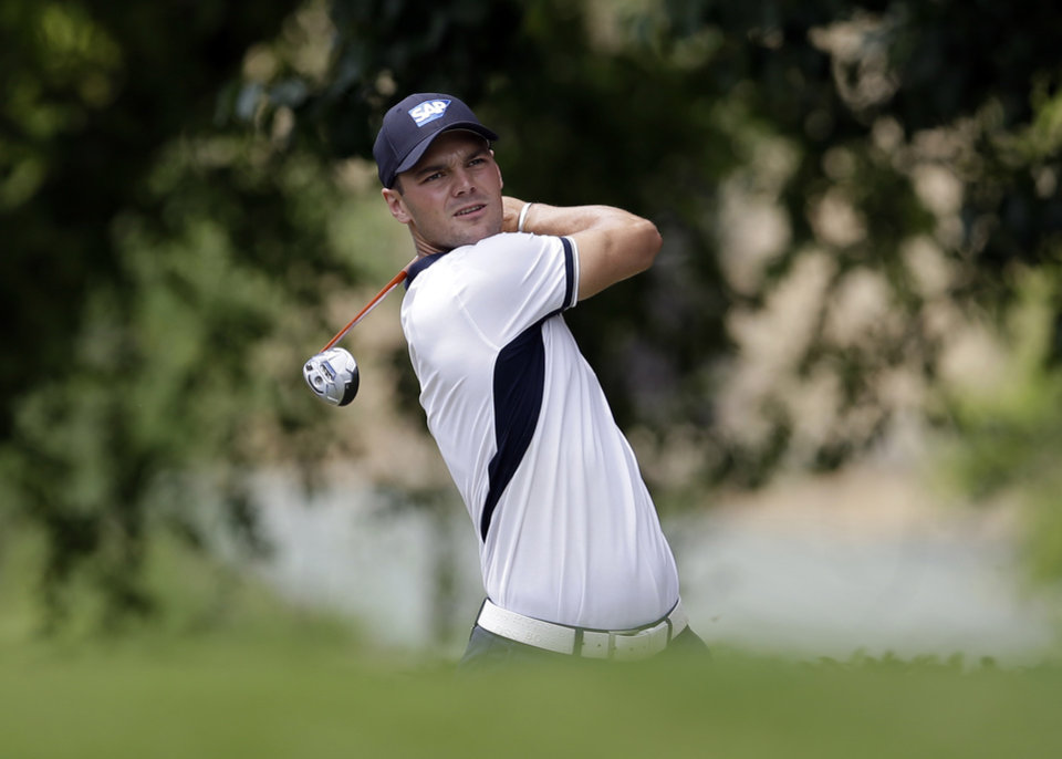 Photo - Martin Kaymer, of Germany, watches his shot off the first tee during the third round of the Byron Nelson Championship golf tournament, Saturday, May 17, 2014, in Irving, Texas. (AP Photo/Tony Gutierrez)