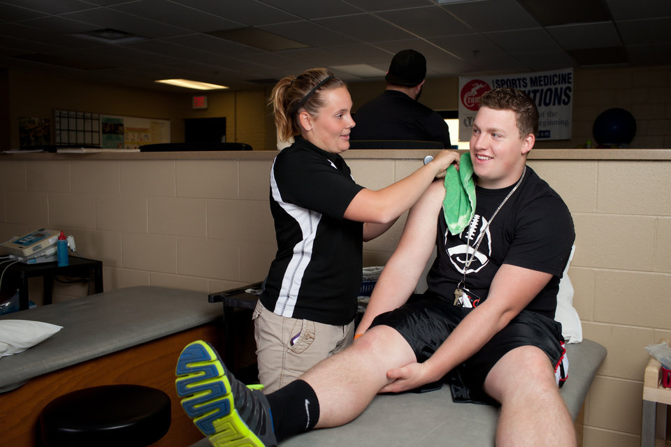 This 2012 photo provided by Adrian College shows students at the school's Athletic Training Lab in Adrian, Mich. For today's increasingly career-focused students, a liberal arts education is a tough sell. So, many small liberal arts colleges are shifting toward a pre-professional curriculum. (AP Photo/Adrian College, Mike Miller)
